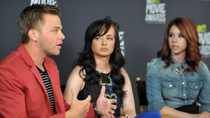 """From left, Brett Davern, Ashley Rickards and Jillian Rose Reed, from the cast of """"Awkward."""" participate in an interview during the MTV Movie Awards Press Day at Sony Studios on Thursday, April 11, 2013, in Culver City, Calif. (Photo by John Shearer/Invision for MTV Networks/AP Images)"""