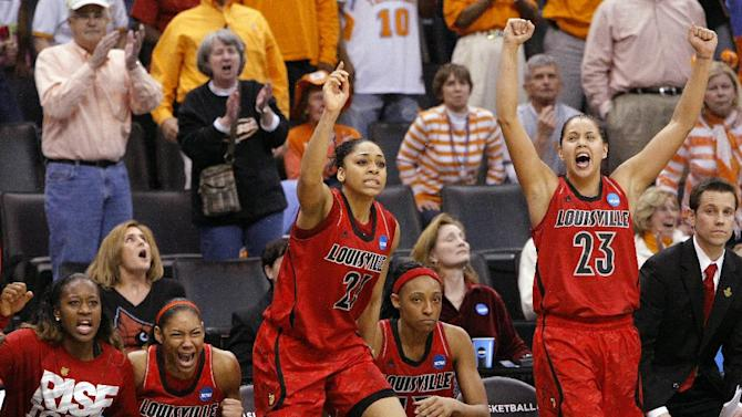 Louisville's bench, including Bria Smith (21) and Shoni Schimmel (23), celebrates the winning free throws against Baylor during the second half of a regional semifinal in the women's NCAA college basketball tournament in Oklahoma City, Sunday, March 31, 2013. Louisville won 82-81. (AP Photo/Alonzo Adams)