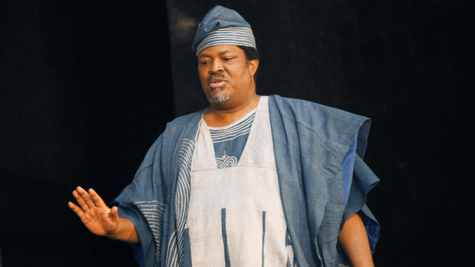 In this photo taken, Tuesday, Feb. 26, 2013. Chairman This Day, Nduka Obaigbena,  gestures during the annual This Day awards, in Abeokuta, Nigeria.  Known more for bringing in celebrities and smiling in photographs next to former Western leaders, a flamboyant Nigerian newspaper publisher now faces a challenge from his most vocal critics _ his own employees. Workers have barricaded the front of This Day newspapers in Lagos, hoping to force publisher Nduka Obaigbena into paying them as much as four months' worth of back salaries due to them. Back pay disputes often hit industries in Nigeria, a country where steady paying jobs remain few, but this crisis has hit a man politically connected to the nation's ruling elite, the second such major business figure to be stung in recent months. (AP Photos/Sunday Alamba)