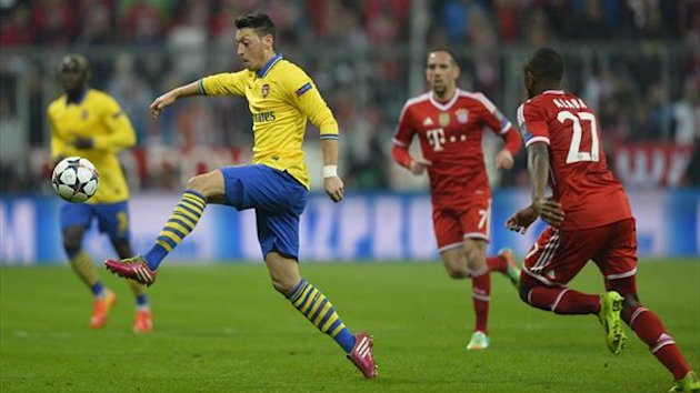 Arsenal's Mesut Ozil in action against Bayern Munich (AFP)
