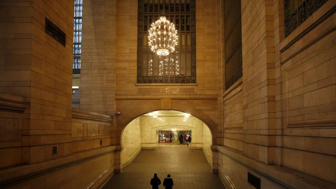 Two commuters pass through a hallway in Grand Central Station terminal in Midtown Manhattan in New York city