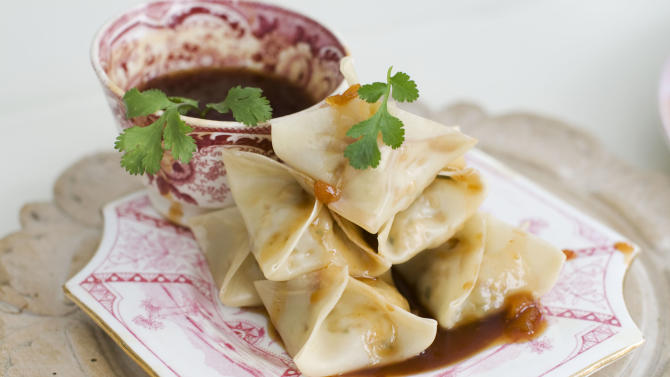 In this image taken on January 14, 2013, vegetarian steamed dumplings with sweet-and-sour sauce are shown served on a plate in Concord, N.H. (AP Photo/Matthew Mead)
