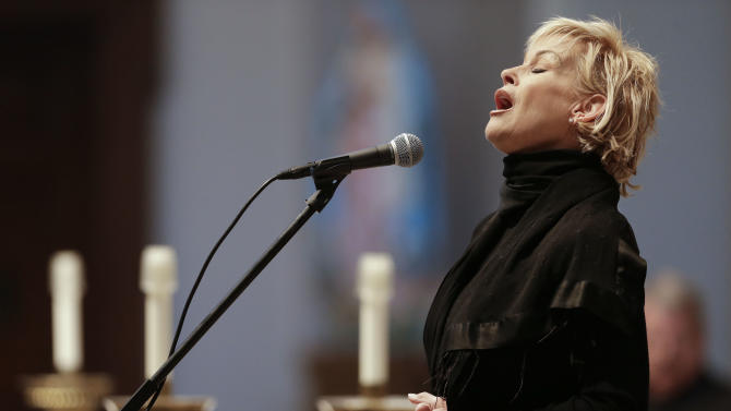 """Lorrie Morgan sings """"Ave Maria"""" during a memorial service for fellow country singer Mindy McCready on Wednesday, March 6, 2013, in Nashville, Tenn. McCready committed suicide Feb. 17 in Heber Springs, Ark. Old friends and family members spoke about her difficulties and triumphs during the hour-long remembrance Wednesday at the Cathedral of the Incarnation. (AP Photo/Mark Humphrey)"""