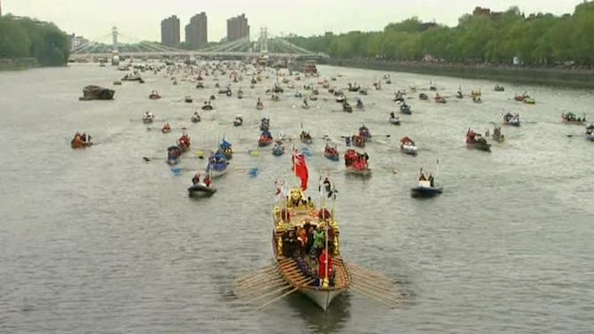 In this image taken from TV the Gloriana leads part of the flotilla  of 1,000 vessels, on the River Thames, during a river pageant to celebrate the queen's Diamond Jubilee in London, Sunday, June 3, 2012.  An armada of vessels, from historic sailboats and barges to kayaks, lifeboats and military launches, took part in Sunday's river pageant to mark the queen's 60 years on the throne.  (AP Photo/SKY TV via APTN) UNITED KINGDOM OUT TV OUT