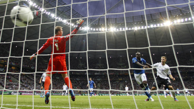 Italy's Mario Balotelli scores the first goal during the Euro 2012 soccer championship semifinal match between Germany and Italy in Warsaw, Poland, Thursday, June 28, 2012. (AP Photo/Matthias Schrader)