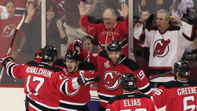 New Jersey Devils' Zach Parise, second from left, celebrates with teammates after scoring a goal in the first period during Game 5 of the NHL hockey Stanley Cup finals against the Los Angeles Kings Saturday, June 9, 2012, in Newark, N.J.. (AP Photo/Frank Franklin II)