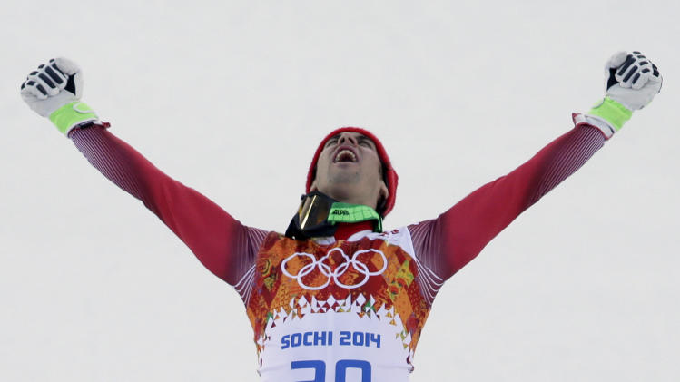 Men's supercombined gold medal winner Switzerland's Sandro Viletta celebrates on the podium during a flower ceremony at the Sochi 2014 Winter Olympics, Friday, Feb. 14, 2014, in Krasnaya Polyana, Russia. (AP Photo/Gero Breloer)