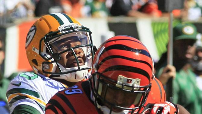 Newman's return rallies Bengals over Packers 34-30