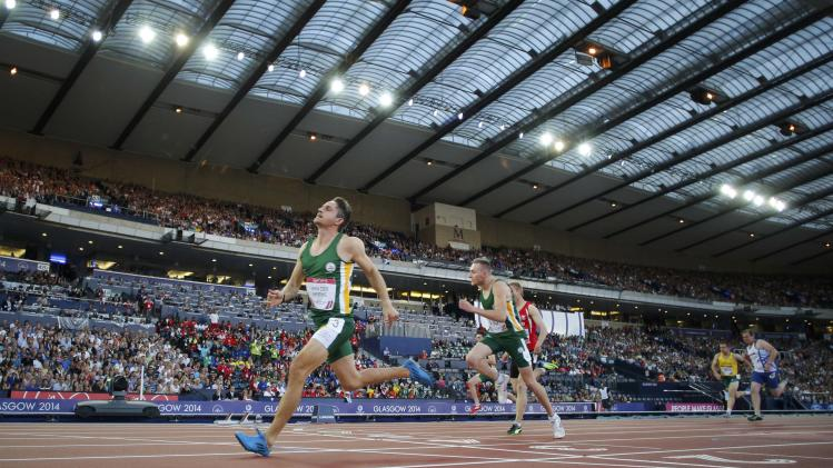 Van Der Merwe celebrates wins the Men's Para-Sport 100m - T37 at the 2014 Commonwealth Games in Glasgow