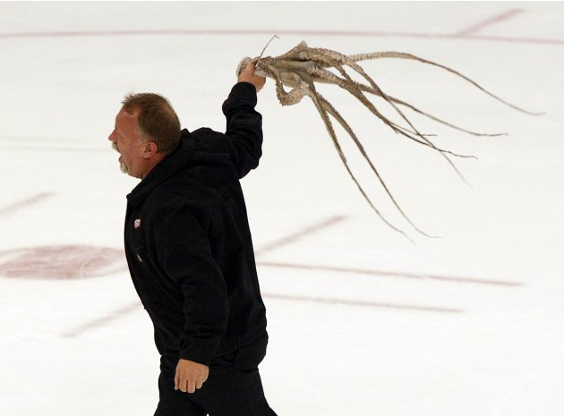 Detroit zamboni driver Al Sobotka holds an octopus thrown onto the ice by a fan in the 3rd period of Game 3 of the NHL Western Conference semi-finals hockey game between the Chicago Blackhawks and the