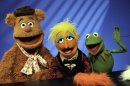 "FILE - In this Nov. 24, 2008 file photo, Muppets Fozzie Bear, left, a Whatnot, center, and Kermit the Frog make a television appearance in New York. Kermit, Miss Piggy, Bert and Ernie of ""Sesame Street"" fame, the stars of ""Fraggle Rock"" and other puppets, costumes and items from throughout Muppets creator Jim Henson's career have been donated to the Museum of the Moving Image, which is building a new gallery to house them, the institution announced Tuesday, May 21, 2013.(AP Photo/Richard Drew, File"