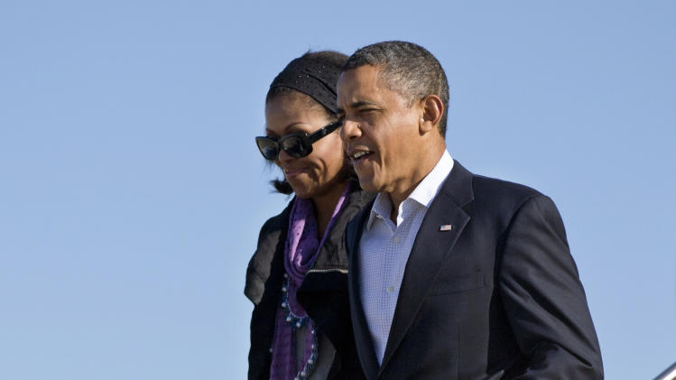 President Barack Obama and first lady Michelle Obama arrive on Air Force One, Sunday, Jan. 6, 2013, at Andrews Air Force Base, Md., as they return from their Hawaii vacation. (AP Photo/Carolyn Kaster)