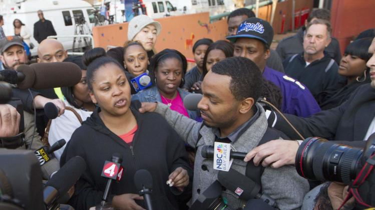 Nailah Winkfield, the mother of Jahi McMath, along with Jahi's uncle Omari Sealy, speak with the media outside Children's Hospital and Research Center in Oakland