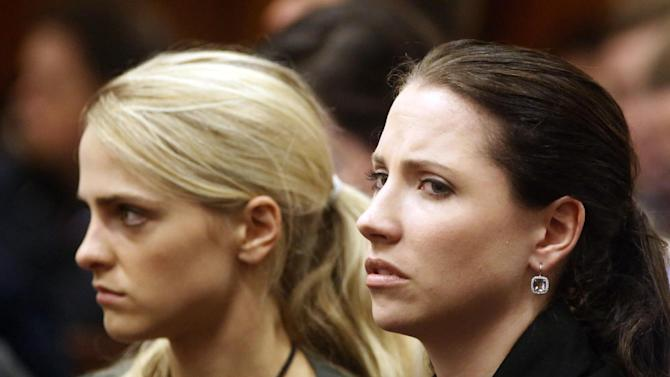 Sister of Oscar Pistorius, Aimee, right, listens to cross questioning in court during his trial at the high court in Pretoria, South Africa, Friday, March 7, 2014. Pistorius is charged with murder for the shooting death of his girlfriend, Steenkamp, on Valentines Day in 2013. (AP Photo/Schalk van Zuydam, Pool)