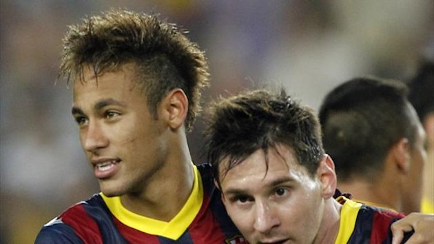 "Barcelona's Neymar (L) and Lionel Messi celebrate victory over Real Madrid at the end of their Spanish first division ""Clasico"" soccer match at Nou Camp stadium in Barcelona October 26, 2013 (Reuters)"