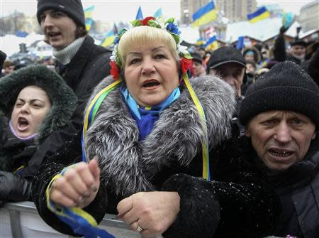 Pro-European integration protesters take part in a rally in Independence Square in Kiev