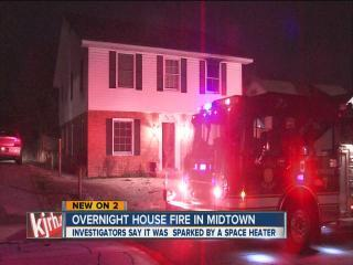 Woman helps contain fire at Tulsa duplex