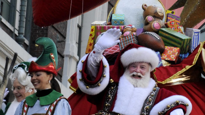 Santa and Mrs. Claus wave to the crowd at Herald Square during the 86th annual Macy's Thanksgiving Day Parade,Thursday, Nov 22, 2012, in New York (AP Photo/ Louis Lanzano)