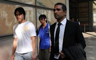 Yong Yun Leong (left) and Yong Yun Chung (centre), the brothers of convicted Malaysian drug trafficker Yong Vui Kong, leave the High Court with lawyer M Ravi, in Singapore on April 4, 2011. Yong Vui Kong, on death ro for drug trafficking had what could be his final appeal thrown out on Wednesday by the city-state's highest court