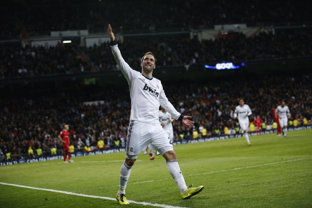 Real Madrid's Higuain celebrates scoring against Real Mallorca during their Spanish first division soccer match at Santiago Bernabeu stadium in Madrid