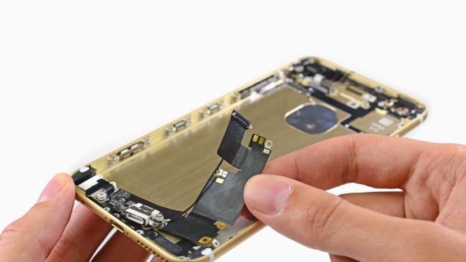 The Lightning connector assembly of the Apple iPhone 6 is shown during a product teardown by iFixit in Melbourne, Australia