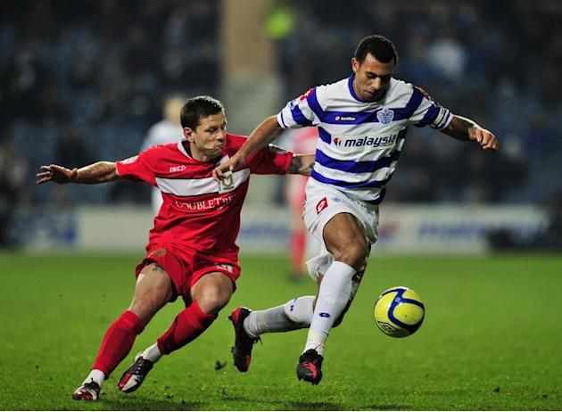 Queen's Park Rangers' English Defender Anton Ferdinand (R) Vies With Milton Keynes Dons' English Striker Charlie AFP/Getty Images