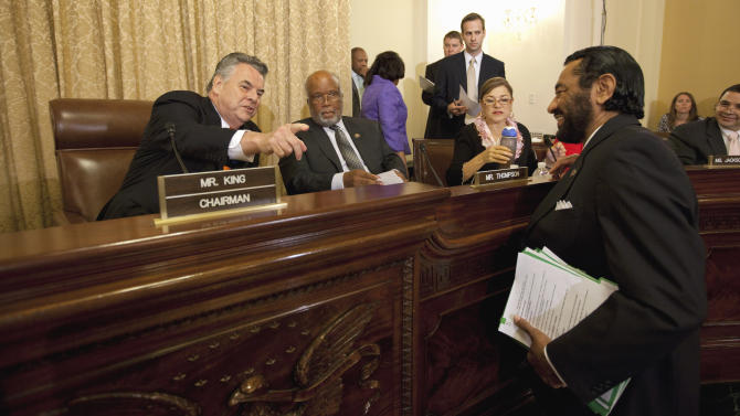 House Homeland Security Committee Chairman Rep. Peter King, D-N.Y., left, speaks with, from second from left, committee members, Rep. Bennie Thompson, R-Miss.,  the committee's ranking Democrat; Rep. Loretta Sanchez, D-Calif.; and Rep. Al Green, D-Texas, on Capitol Hill in Washington, Wednesday, July 27, 2011, before the committee's hearing on Islamic radicalization in the US, focusing on recruitment within the Muslim American community.  (AP Photo/Evan Vucci)
