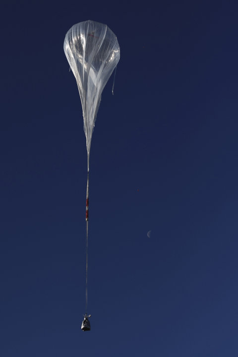 In this photo provided by Red Bull Stratos, the balloon carrying Felix Baumgartner ascends during the first manned test flight for Red Bull Stratos in Roswell, N.M. on Thursday, March 15, 2012. Baumga
