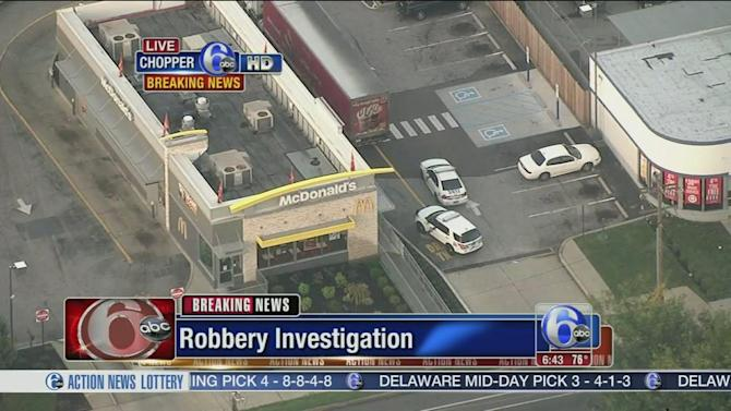 McDonald's robber gets away in a cab
