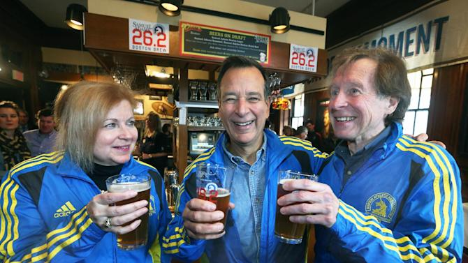 IMAGE DISTRIBUTED FOR SAMUEL ADAMS - In this photo from Samuel Adams, Founder and Brewer Jim Koch, marathon legend Bill Rodgers and President of the Boston Athletic Association Joann Flaminio tap the first keg, and toast with Samuel Adams Boston 26.2 Brew at Boston's historic Hampshire House.  The beer commemorates the 117th Boston Marathon and recognizes the alliance of two of Boston's beloved icons – bringing together a Boston-born brewery with the biggest of Boston traditions. Boston 26.2 Brew embodies the race in style, aroma, and flavor. The light-bodied, Gose style ale is as rare and exceptional a brew as the remarkable athletes that run the Boston Marathon. With a lighter body and lower alcohol level (4.5%) than most Samuel Adams beers, Boston 26.2 Brew is fitting for those running the race or cheering on their favorite runners.  This beer is available on draft for a limited time at pubs along the Marathon route and around Boston. (Samuel Adams via AP Images)