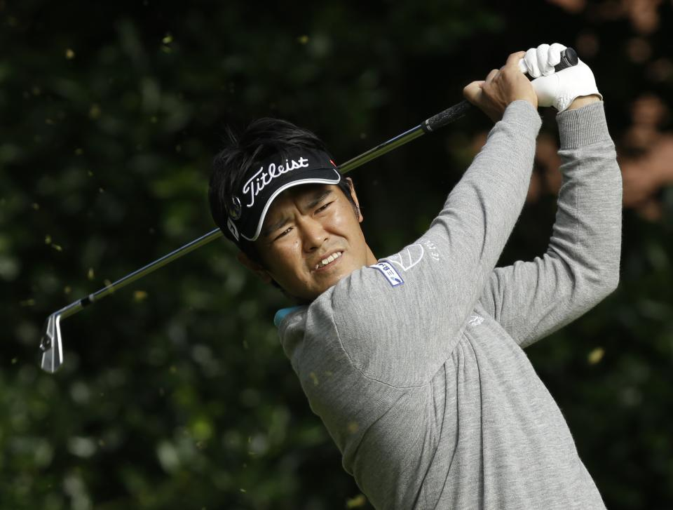 Toshinori Muto of Japan plays a shot off the first tee at Royal Lytham & St Annes golf club during the second round of the British Open Golf Championship, Lytham St Annes, England, Friday, July 20, 2012. (AP Photo/Jon Super)