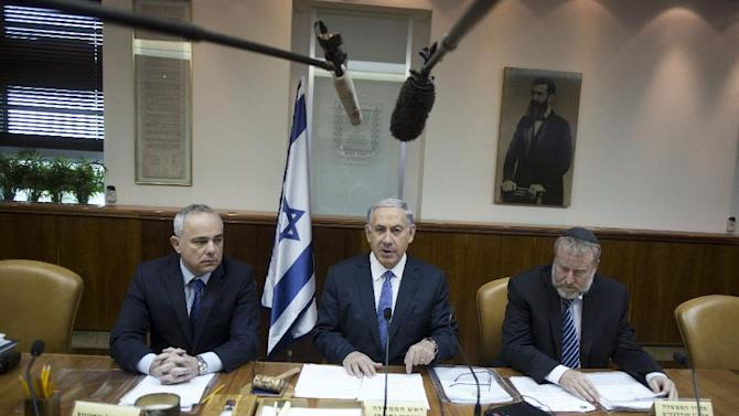 Benjamin Netanyahu (centre), flanked by Intelligence Minister Yuval Steinitz (left) and Cabinet Secretary Avichai Mendelblit at the weekly cabinet meeting in his Jerusalem office on February 15, 2015