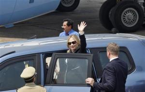U.S. Secretary of State Clinton waves from a car upon her arrival at the airport in Kolkata