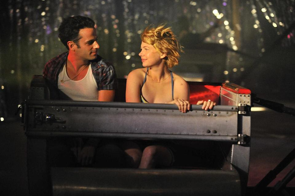 "This film image released by Magnolia Pictures shows Luke Kirby, left, and Michelle Williams in a scene from ""Take This Waltz."" (AP Photo/Magnolia Pictures)"