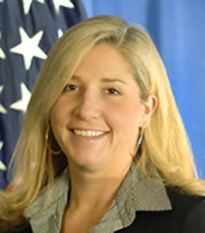 """This undated image provided by the U.S. Department of Homeland Security shows Chief of Staff Suzanne Barr. A senior agent for Immigration and Customs Enforcement and the U.S. government have agreed to settle a discrimination lawsuit out of court, according a court record filed Thursday. In a two-sentence notice, a lawyer for ICE Agent James T. Hayes Jr. said the """"parties have come to an agreement in principal"""" to settle the case for $175,000. Hayes' attorney Morris Fischer, wrote that along with the money, """"a formal settlement agreement will be executed within the next several days"""" that will include other conditions, including Hayes keeping his job.  Hayes filed the lawsuit in May and described a """"frat house"""" environment at ICE that humiliated male employees under Barr. (AP Photo/U.S. Department of Homeland Security)"""