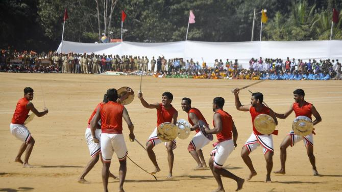 Members of the Indian military perform Kalaripayattu, a traditional form of martial arts, as they take part in the Republic Day celebrations in Bengaluru
