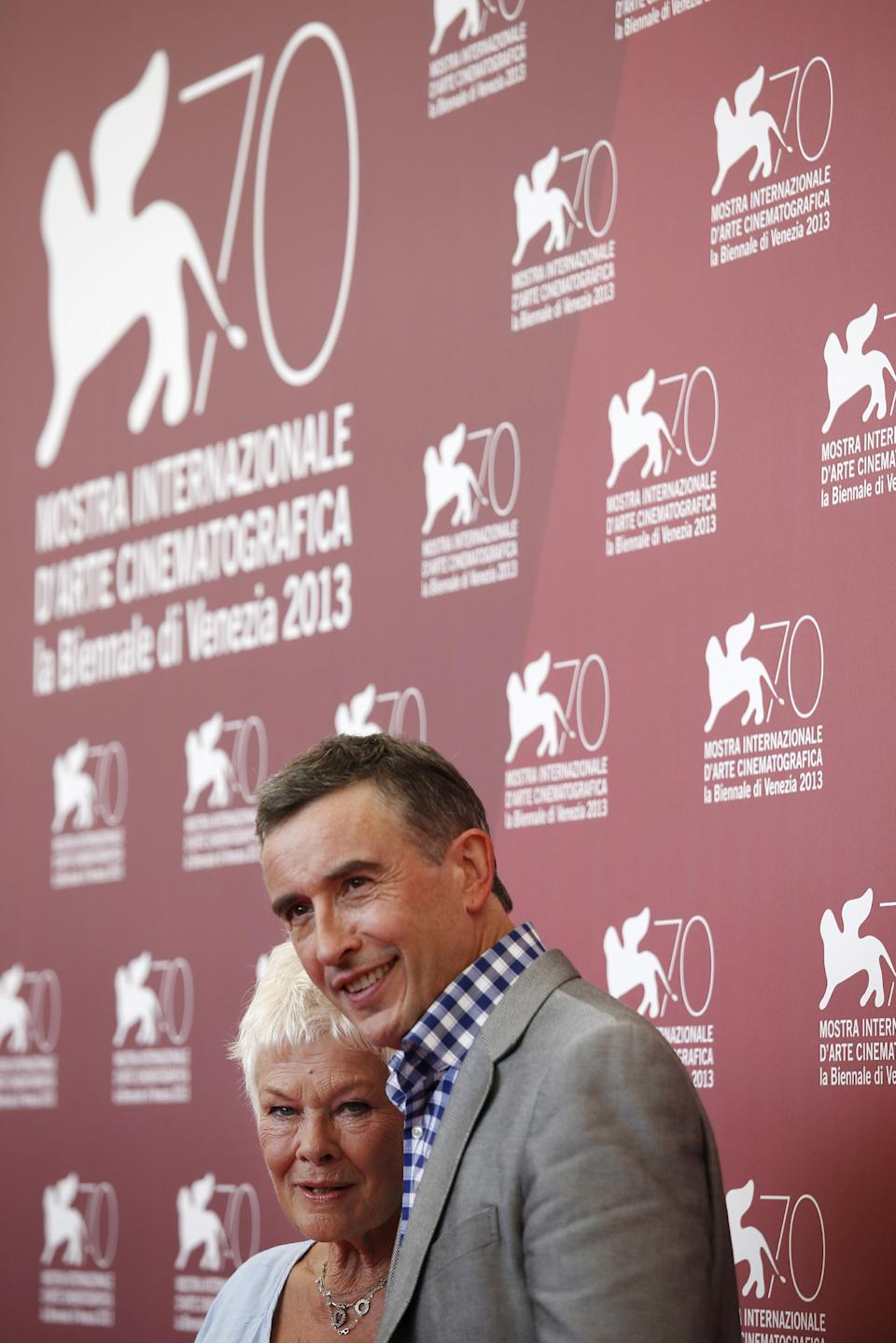 Actor Judi Dench, left, and Steve Coogan pose for photographers during a photo call to promote the film Philomena at the 70th edition of the Venice Film Festival held from Aug. 28 through Sept. 7, in Venice, Italy, Saturday, Aug. 31, 2013. (AP Photo/David Azia)