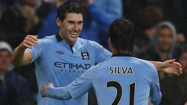 Manchester City's Gareth Barry (L) celebrates his goal against Reading (Reuters)