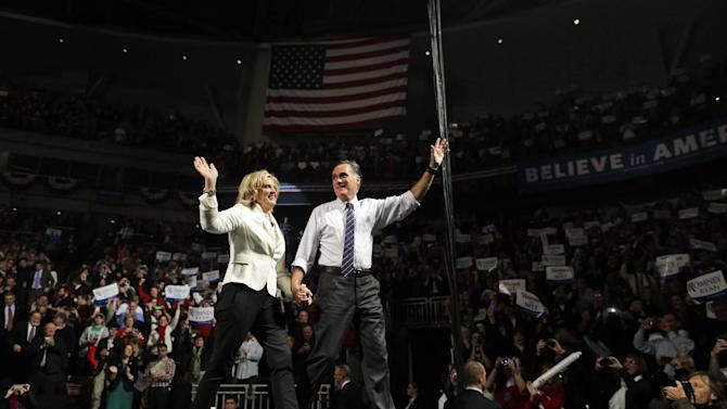 Republican presidential candidate and former Massachusetts Gov. Mitt Romney and Ann Romney arrive at a New Hampshire campaign rally at Verizon Wireless Arena in Manchester, N.H., Monday, Nov. 5, 2012. (AP Photo/Charles Dharapak)