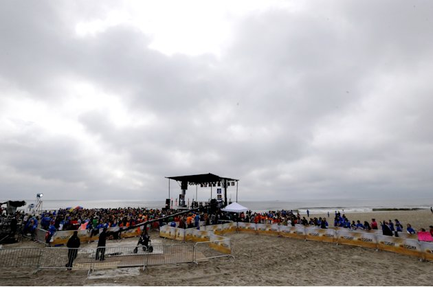 People gather around a stage as musical group Fun performs on the beach, Friday, May 24, 2013, in Seaside Heights, N.J. New Jersey Gov. Chris Christie cut a ribbon to symbolically reopen the state's s
