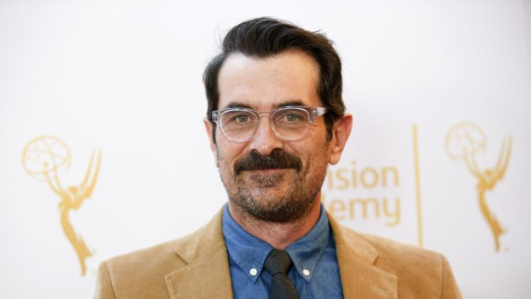 Burrell poses at the Television Academy's Performers Peer Group cocktail reception to celebrate the 66th Primetime Emmy Awards in Beverly Hills