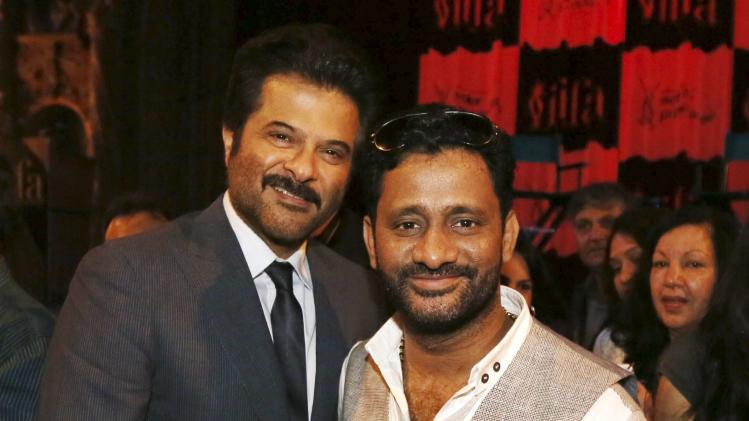 Bollywood actor Anil Kapoor poses with Oscar winner Resul Pookutty ahead of the 15th International Indian Film Academy Awards in Tampa