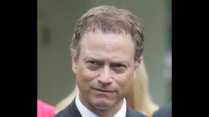 "FILE - Actor Gary Sinise listens to a media question after a meeting between President Bush and organizations that support the U.S. military in Iraq and Afghanistan in this June 26, 2006 file photo taken in the Roosevelt Room of the White House in Washington. The ""Forrest Gump"" star helped kickoff ticket sales for ""Rockin' for the Troops"" on Thursday May 3, 2012 at the Navistar headquarters in Lisle. (AP Photo/Ron Edmonds, File)"