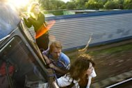 Political activists Yekaterina Samutsevich (L) Oleg Vorotnikov (C) and Natalia Sokol travel on the outside of a commuter train, refusing to buy tickets, outside of Moscow, June 2, 2008. Yekaterina Samutsevich later became a member of the Russian female punk group Pussy Riot.