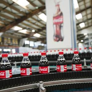 Coke Changes Executive Pay Plan, and More