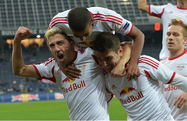 Salzburg's Kevin Kampl, Alan  and Jonatan Soriano,  from left, celebrate after scoring  during the Europa League group C soccer match  between Red  Bull Salzburg and Standard  Liege  in Salzburg, Aust
