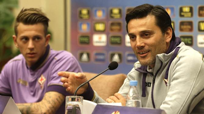 ACF Fiorentina's head coach Vincenzo Montella, right, speaks during a news conference with Federico Bernardeschi in Minsk, Belarus, Wednesday, Oct. 1, 2014.  ACF Fiorentina will face FC Dinamo MInsk on Thursday in their Europa League Group Stage in group K soccer match in Borisov. (AP Photo/Sergei Grits)