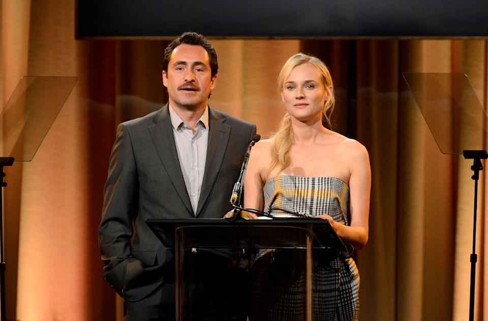 Demian Bichir, left, and Diane Kruger speak on stage at the Hollywood Foreign Press Association Luncheon at the Beverly Hilton Hotel on Tuesday, Aug. 13, 2013, in Beverly Hills, Calif. (Photo by Chris Pizzello/Invision/AP)