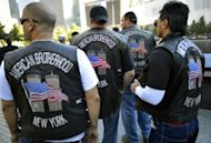 Members of the American Brotherhood New York Motorcycle Club at the South Tower pool during observances held on the eleventh anniversary of the attacks on the World Trade Center, at the site in New York