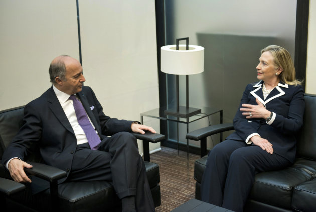 US Secretary of State Hillary Clinton, right, speaks with French Foreign Minister Laurent Fabius during a meeting , in Paris, Friday July 6, 2012. Syrian opposition leaders are pressing diplomats at an international conference for a no-fly zone over Syria, but the U.S. and its European and Arab partners are expected to focus on economic sanctions instead. (AP Photo/Brendan Smialowski, Pool)